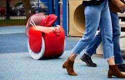 gita robot carrying a family's gear through a playground